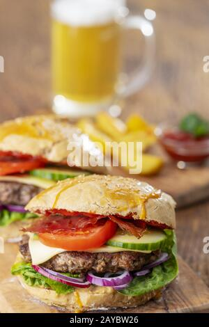 homemade burger on dark wood - Stock Photo