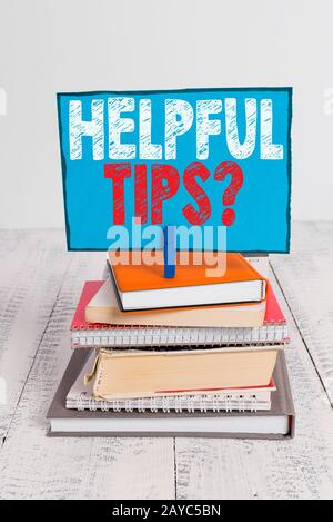 Writing note showing Helpful Tips Question. Business photo showcasing secret information or advice given to be helpful knowledge - Stock Photo