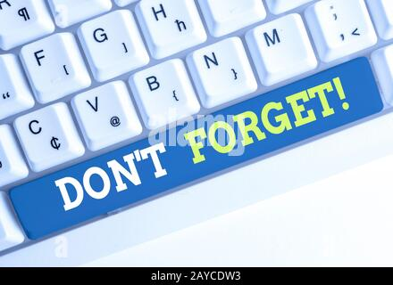 Conceptual hand writing showing Don T Forget. Business photo text used to remind someone about important fact or detail White pc
