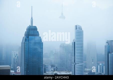 Top view of foggy Kuala Lumpur city skyline in the morning . - Stock Photo