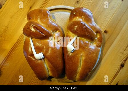 bread roll man, traditional German sweet pastry  with a clay pipe, baked for St. Nicholas' Day Stock Photo