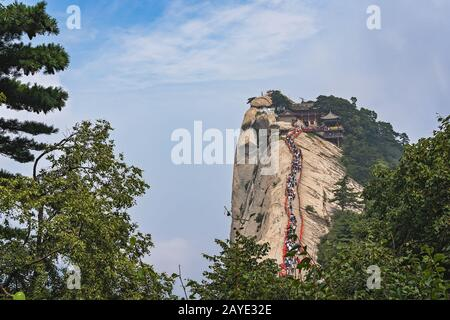 Crowds on a ridge at West Peak in Huashan mountain - Stock Photo