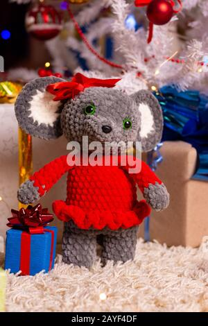 Plush toy mouse girl on New Year's background - Stock Photo