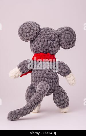 Funny knitted teddy mouse, Rear view, white background - Stock Photo
