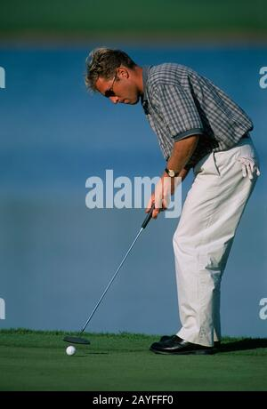 Per Ulrik Johansson of Sweden putting for birdie on the 17th hole during the Dubai Desert Classic 1996, 19th-22nd January - Emirates Golf Club, Dubai, - Stock Photo