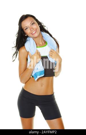 Eine junge Frau hat Spass im Fitnessstudio. Fit durch Gymnastik und Workout, MR: Yes