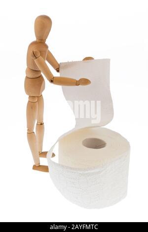 Eine Holzfigur und eine Rolle Toilettenpapier Stock Photo