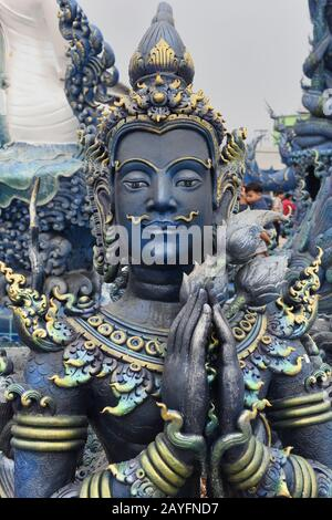 Statue of Buddha in the grounds of Wat Rong Seur Ten, otherwise known as the Blue Temple, Rim Kok, Chiang Rai Province, Thailand - Stock Photo