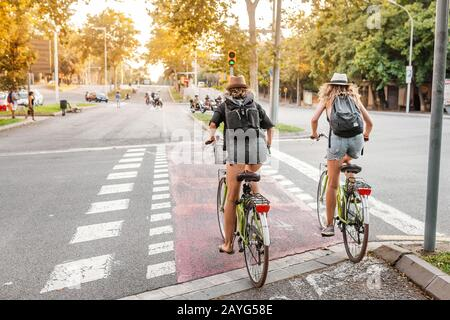 29 JULY 2018, BARCELONA, SPAIN: Cyclists crossing road intersection. Bicycle as urban transport - Stock Photo
