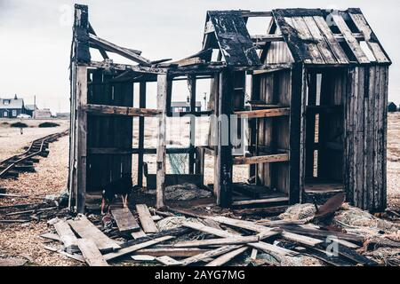 Colour photo of a dilapidated building on Dungeness beach - Stock Photo
