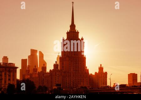 Radisson Royal Hotel (former Ukraine) at sunset, Moscow, Russia. It is a Stalinist skyscraper and landmark of Moscow. Sunny panorama of Moscow