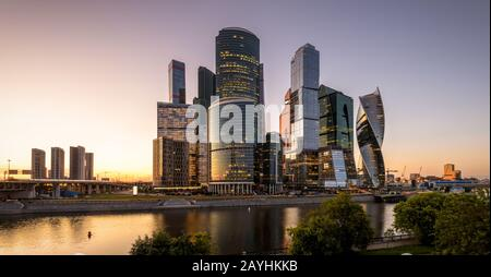 Scenic view of Moscow-City skyscrapers at sunset, Russia. Moscow-City is a district of business and residential towers in Moscow center. Panorama of M - Stock Photo