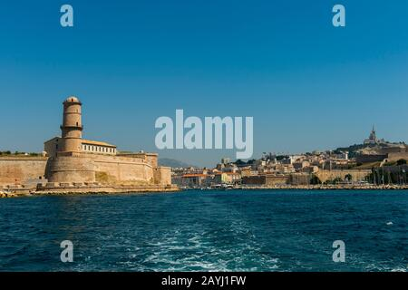View from a boat of Fort St. Jean and the entrance to the Vieux Port (old port) in Marseille, France. - Stock Photo