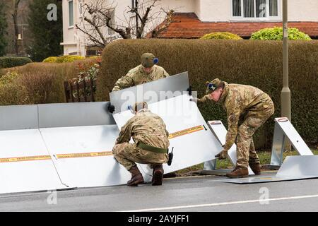 Army errecting flood barriers in Ilkley West Yorkshire, in preparation for arrival of Storm Dennis - Stock Photo