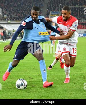 Dusseldorf, Germany. 15th Feb, 2020. Marcus Thuram (L) of Monchengladbach vies with Mathias Jorgensen of Dusseldorf during a German Bundesliga match between Borussia Monchengladbach and Fortuna Dusseldorf in Dusseldorf, Germany, Feb. 15, 2020. Credit: Ulrich Hufnagel/Xinhua/Alamy Live News - Stock Photo