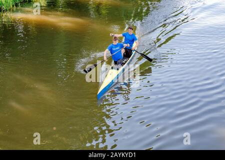 LEIPZIG, GERMANY - MAY 21, 2018: young sportsmen rowing and training on a sunny day at river in Leipzig - Stock Photo