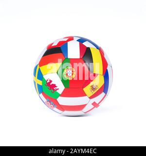 Football or soccer ball decorated with the national flags of the teams competing in the championship or World Cup event on white