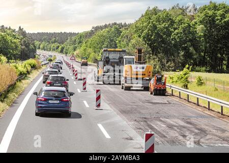 BERLIN, GERMANY, 20 MAY 2018: Traffic jam was formed because of the closed road during repair works on asphalt laying by road services - Stock Photo