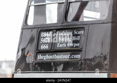 Ghostbustour old London Routemaster bus painted black. Ghost Bus Tours retired London bus used for spooky transport around city. Twisted destinations - Stock Photo