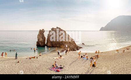 Monterosso al Mare, ITALY - 15 October, 2018: Paradise beach with big cliff in Cinque terre, Ligurian coast - Stock Photo