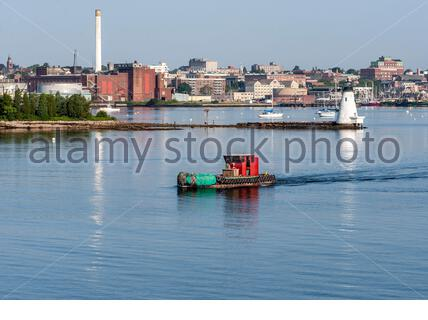 Fairhaven, Massachusetts, USA - July 26, 2019: Water tender Chippy starting out on a run into New Bedford outer harbor on summer morning - Stock Photo