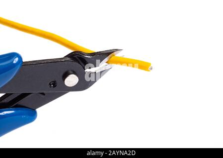 Blue wire cutter cuts yellow wire isolated on white background - Stock Photo