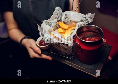 Wiener schnitzel with fried potatoes tray waiter - Stock Photo
