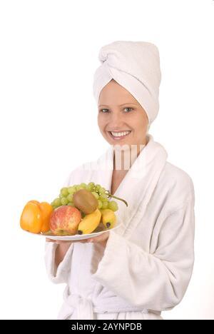 Junge Frau mit Obstteller - Stock Photo