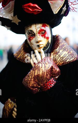 Venice, Italy - February 16, 2020: Masks participants of the 2020 Carnival celebrations St. Mark's Square. - Stock Photo