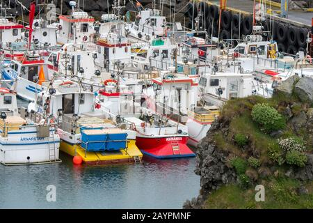 Fishing boats in the fishing harbor at Arnarstapi, on the Snaefellsnes Peninsula in western Iceland. - Stock Photo