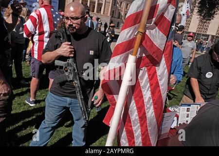 Phoenix, Arizona, USA. 15th Feb, 2020. About 1500 gun rights supporters gather at the Arizona State Capitol in support of the 2nd Ammendment. The rally was called ' Celebrate and Protect the 2nd Ammendment''. Arizona is an open carry state and advocates carry various types of long rifles to show their opposition to any proposed ban on assault weapons. They also are against so called Red Flag laws which allow police to temporarily take away guns from an individual they deam to be a threat against themselves or society. Most show support of President Trump and his strong support for any ch - Stock Photo