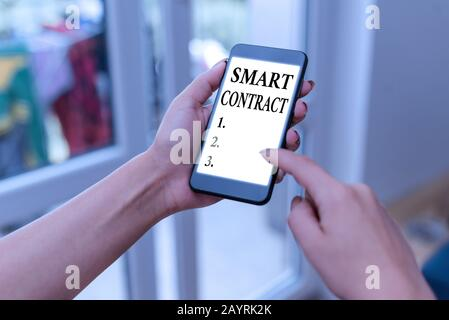 Handwriting text writing Smart Contract. Conceptual photo the computer protocol running on top of a block chain - Stock Photo