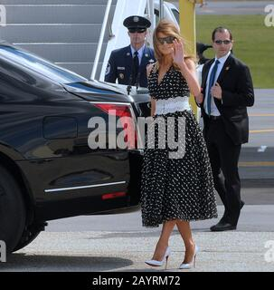 Daytona Beach, United States. 16th Feb, 2020. First Lady Melania Trump waves as she and U.S. President Donald Trump (not pictured) arrive on an Air Force One at Daytona Beach International Airport ahead of Trump's appearance at the Daytona 500 car race. Credit: SOPA Images Limited/Alamy Live News - Stock Photo