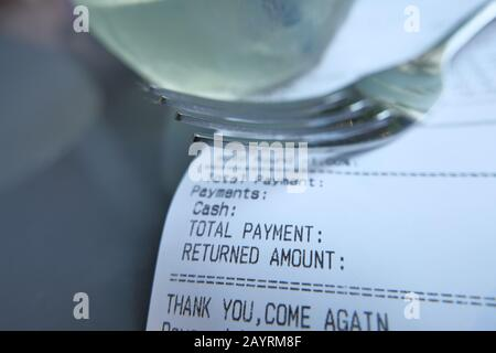 Close up of receipt bill for payment on cafe table  - Stock Photo