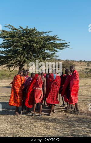 Young Maasai men performing a traditional jumping dance in the Masai Mara in Kenya.
