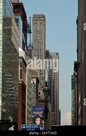The tall and slender art deco Burberry building towering over Madison Avenue, framed windows more tall buildings - Stock Photo