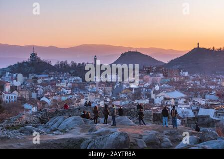 People watching sunset from Nebet tepe Hill in Plovdiv city, Bulgaria - the oldest European city