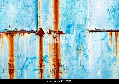 Grunge rusty metal surface painted in blue as weathered industrial background - Stock Photo