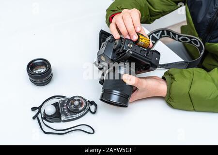 loading a film on old vintage SLR camera