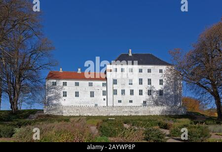 The apparently haunted 12th century medieval Dragsholm Castle in Hørve in north-western part of Zealand, Denmark. Now a famous restaurant and hotel. - Stock Photo