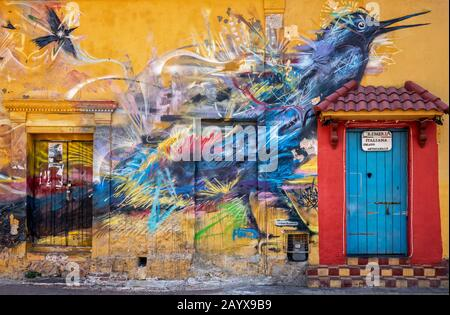 Cartagena, Colombia - January 23, 2020: Graffiti mural of a bird on a house in the Holy Trinity main square (Plaza Trinidad) in Getsemani in Cartagena