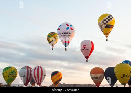 Manacor, Mallorca, Spain - October 27, 2019:  FAI European Hot Air Balloon Championship in Spain. Balloons rising up in the air