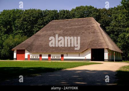 Genk, Flanders, Belgium - AUGUST 30 2019 : Big old traditional flemish barn 'Schuur Zuienkerke' in the open air museum Bokrijk, near Hasselt, on a sun - Stock Photo