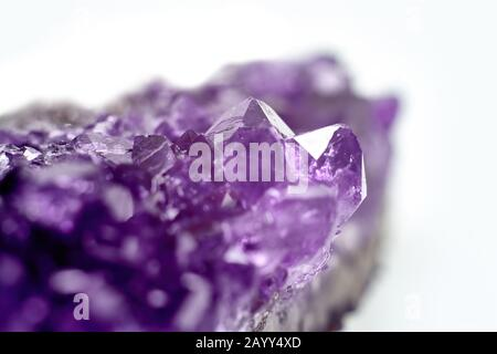 Amethyst crystals geode isolated on white background. Stock photo - Stock Photo