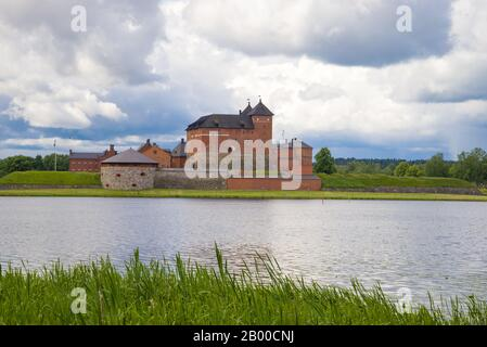 View of the ancient Hameenlinna fortress on a cloudy June day. Finland - Stock Photo