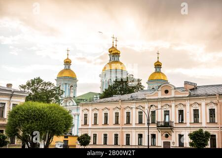St. Nicholas Naval Cathedral, a major Baroque Orthodox cathedral in the western part of Central Saint Petersburg under the sunset. - Stock Photo