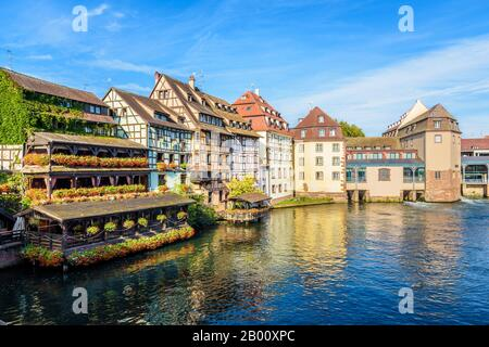 Half-timbered buildings and former water mills lining the river Ill in the Petite France quarter in Strasbourg, France, on a sunny morning.