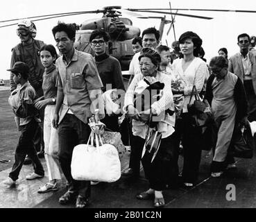 Operation Frequent Wind was the evacuation by helicopter of American civilians and 'at-risk' Vietnamese from Saigon, South Vietnam, on 29–30 April 1975 during the last days of the Vietnam War. More than 7,000 people were evacuated from various points in Saigon, and the airlift left a number of enduring images.  Preparations for the airlift already existed as a standard procedure for American embassies. In the beginning of March, fixed-wing aircraft began evacuating civilians through neighboring countries. By mid-April, contingency plans were in place and preparations were underway for a possib - Stock Photo