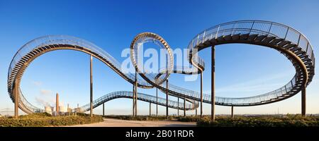 Tiger and Turtle – Magic Mountain, art installation and landmark in Angerpark, Germany, North Rhine-Westphalia, Ruhr Area, Duisburg Stock Photo