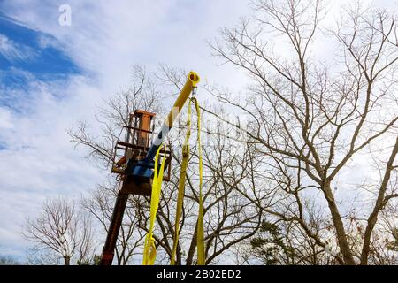 Building industry details in progress boom truck in the roof a new house - Stock Photo